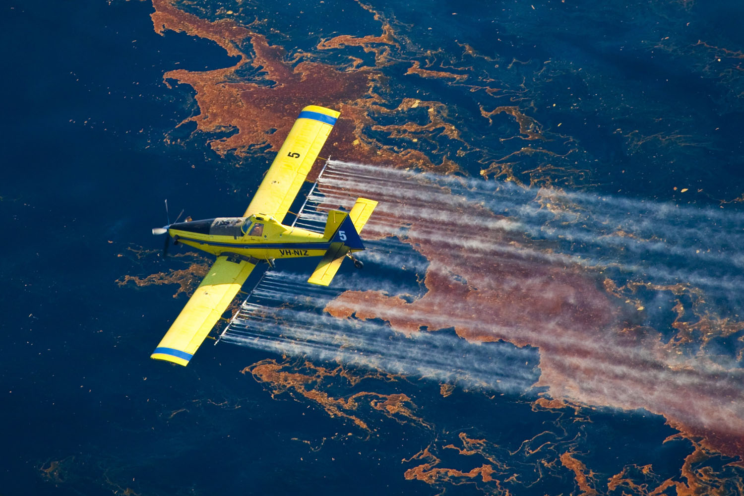 Air Tractor 802 flying over oil spill